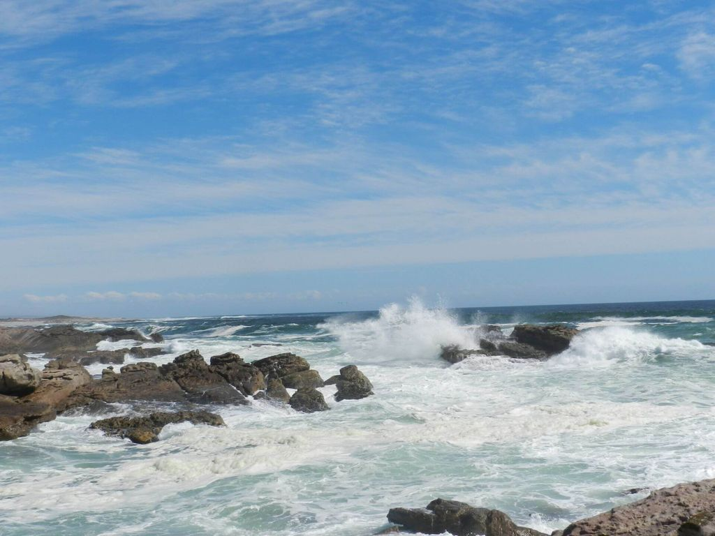 Waves crashing into rocks by the shore
