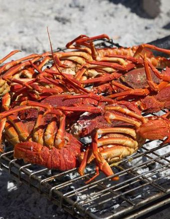 Crayfish being cooked on a grill