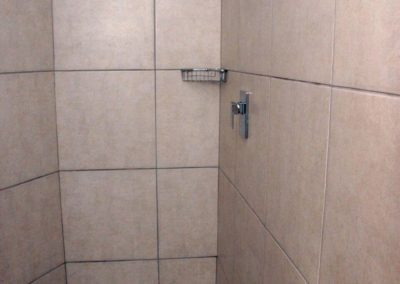 The shower and sink inside the downstairs bathroom
