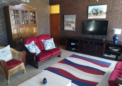 View of the TV and seating inside the lounge area of the self catering house