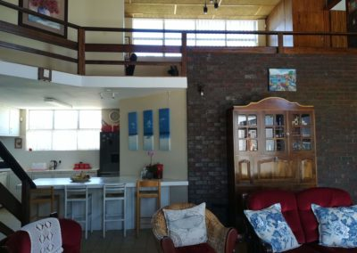 View of the kitchen and upstairs area from the lounge in the self catering house