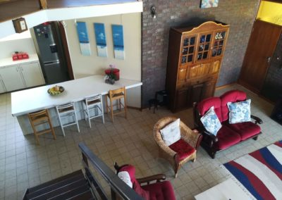 View of the kitchen and lounge from the top of the stairs