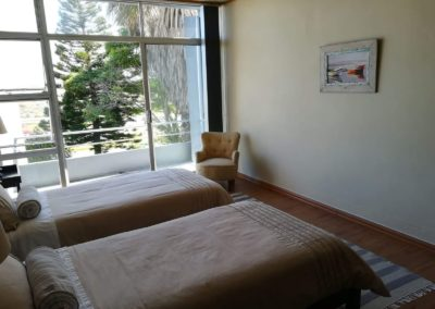 First upstairs bedroom single beds with view onto balcony