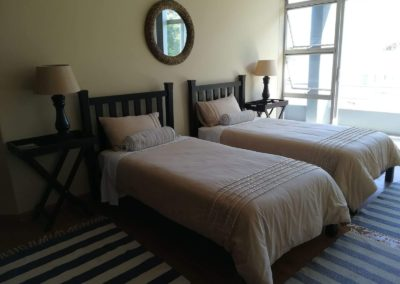 The two single beds inside the first upstairs bedroom