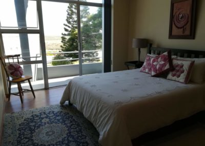 Double bed and view of balcony in second upstairs bedroom