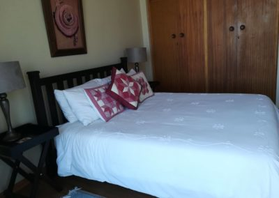 The double bed and cupboards inside the second upstairs bedroom